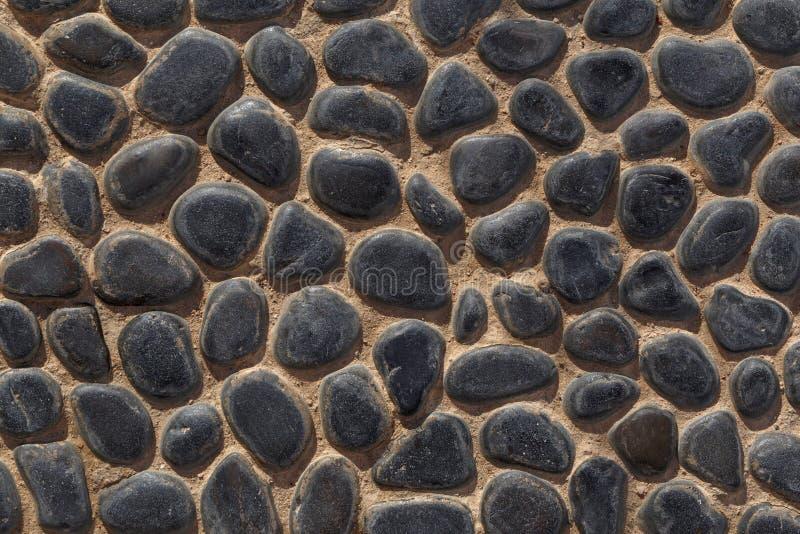 Plancher fait de pavés ronds noirs photo libre de droits