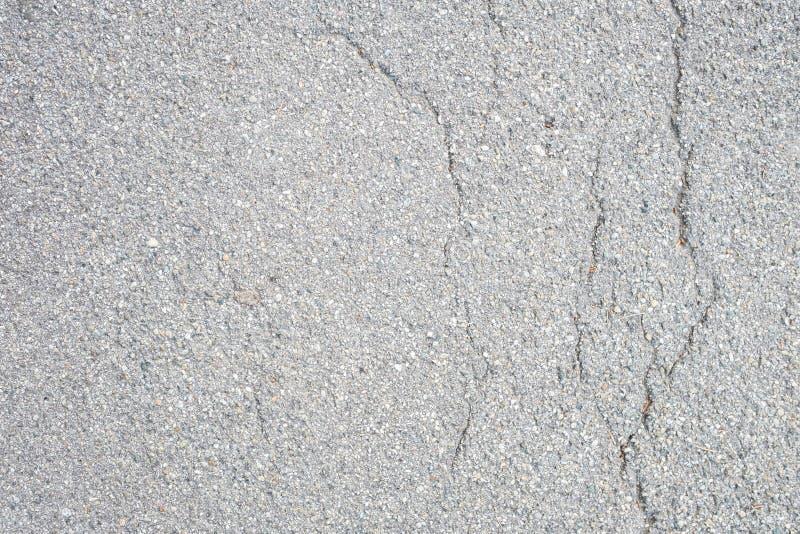 Plancher goudronné gris avec des failles photographie stock
