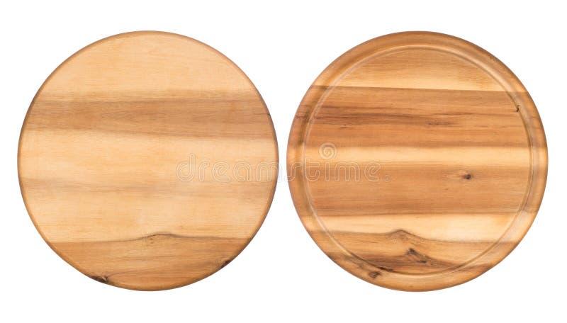 Planches à découper en bois rondes d'isolement sur le fond blanc photographie stock
