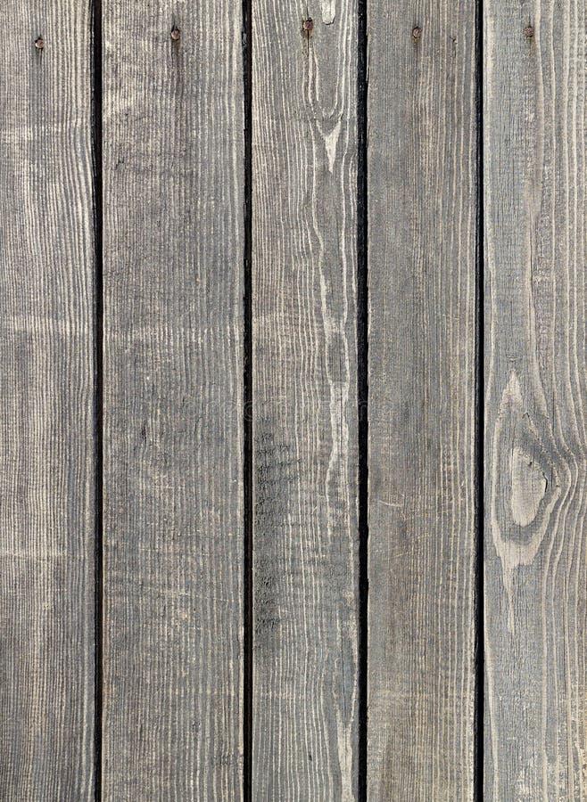 Planches d'une vieille clôture grise en bois image libre de droits