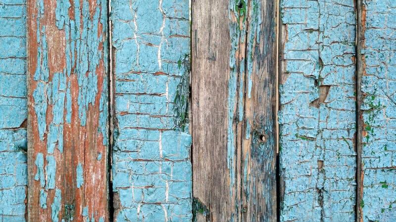 Planches en bois âgées avec la peinture bleue criquée images libres de droits