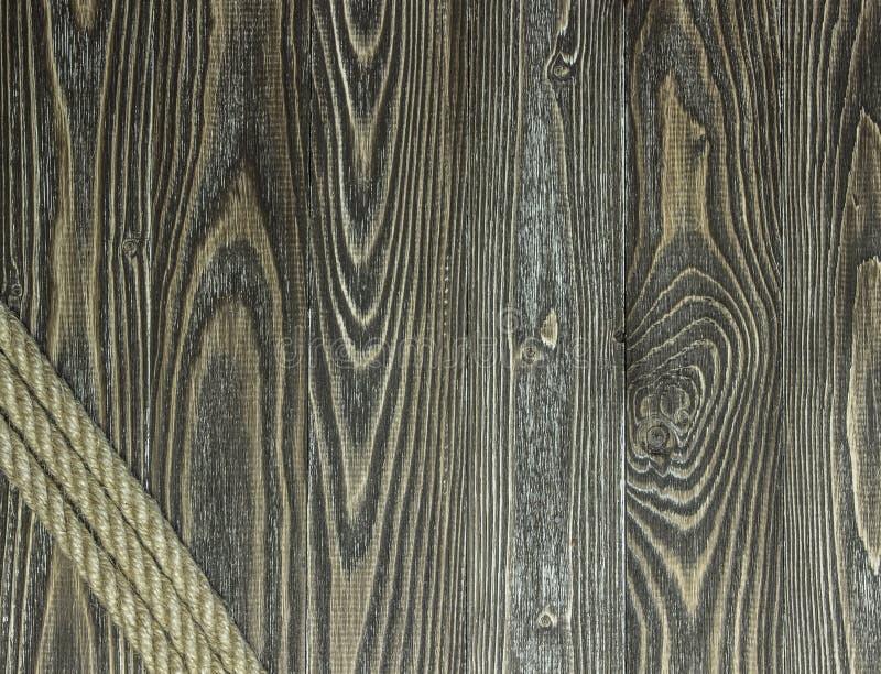 Planches et corde texturisées de pin image stock