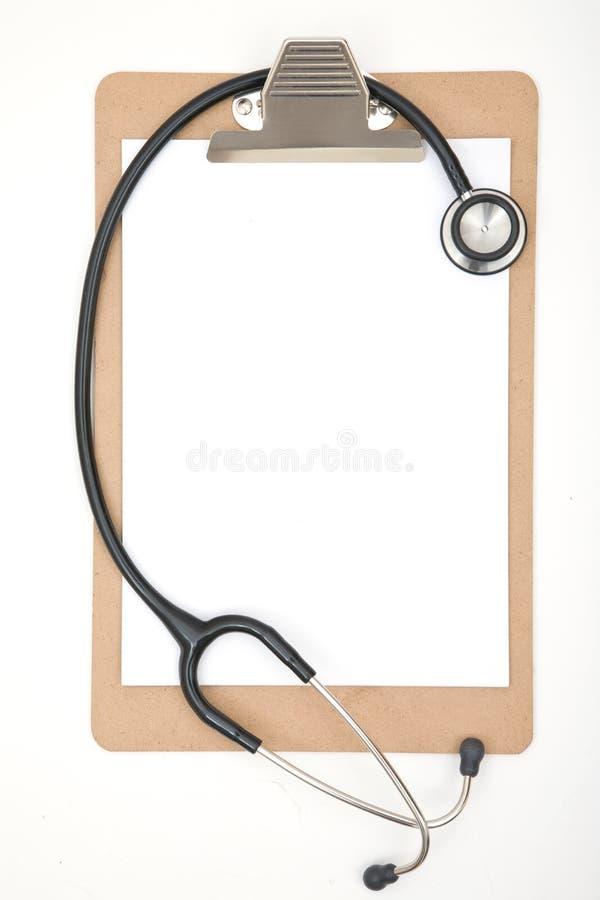 Planchette avec le stéthoscope photographie stock libre de droits