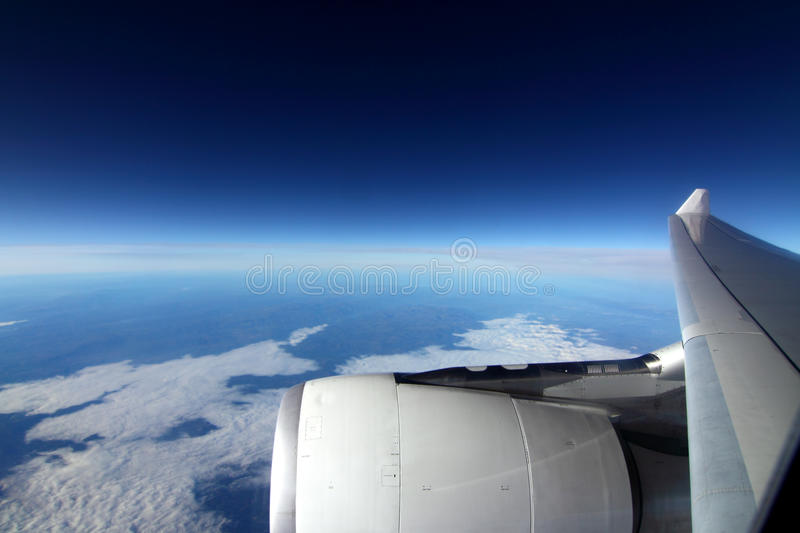 Plane. Wing of the plane on a background of sky royalty free stock photography