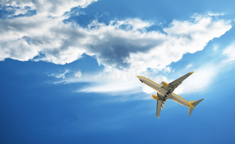 The plane. Flies through clouds stock image