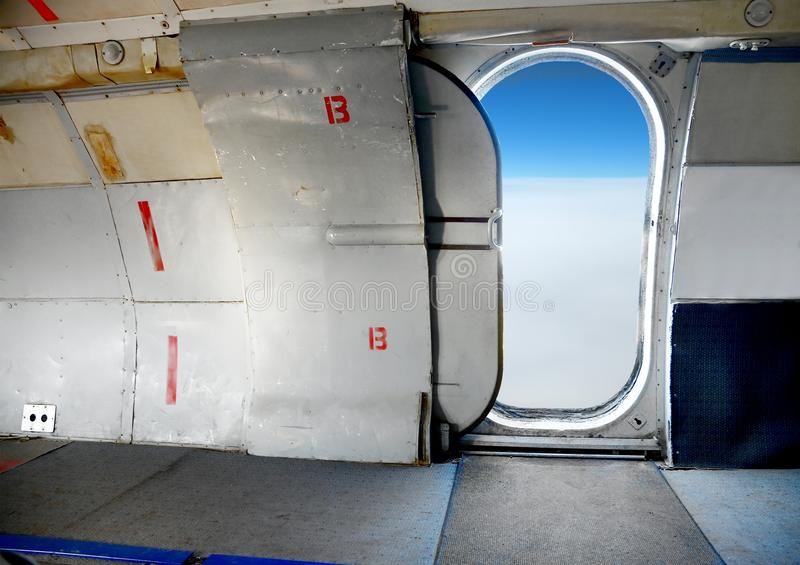 Plane. Interior with open cabin door high up in the sky royalty free stock photos