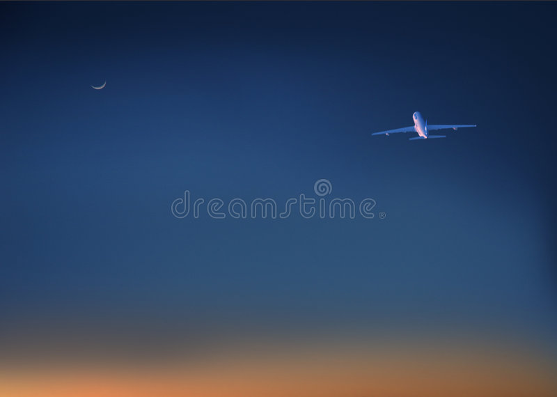 Plane. At dusk stock images