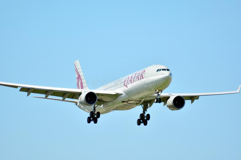Plane A7-AEJ Qatar Airways Airbus A330-302 just before landing at the Chopin airport. stock photos