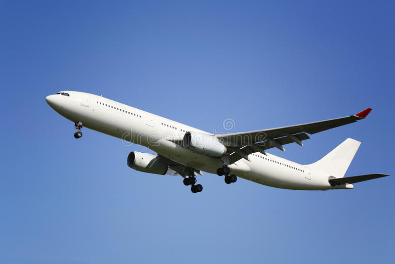 Plane. An air plane flying in blue sky royalty free stock image