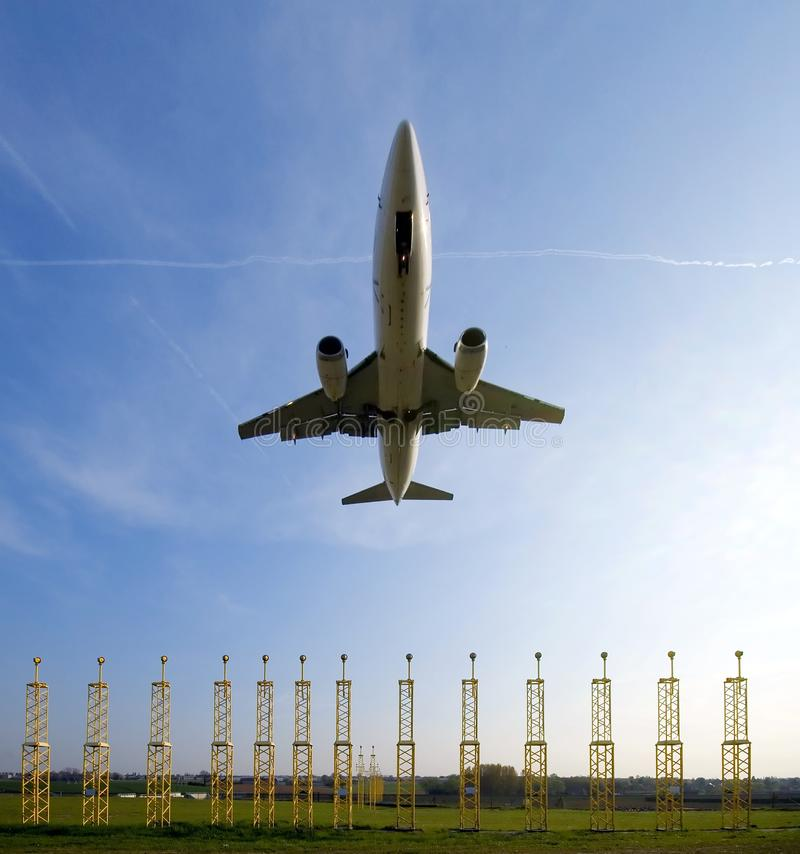 Plane approaching runway stock image