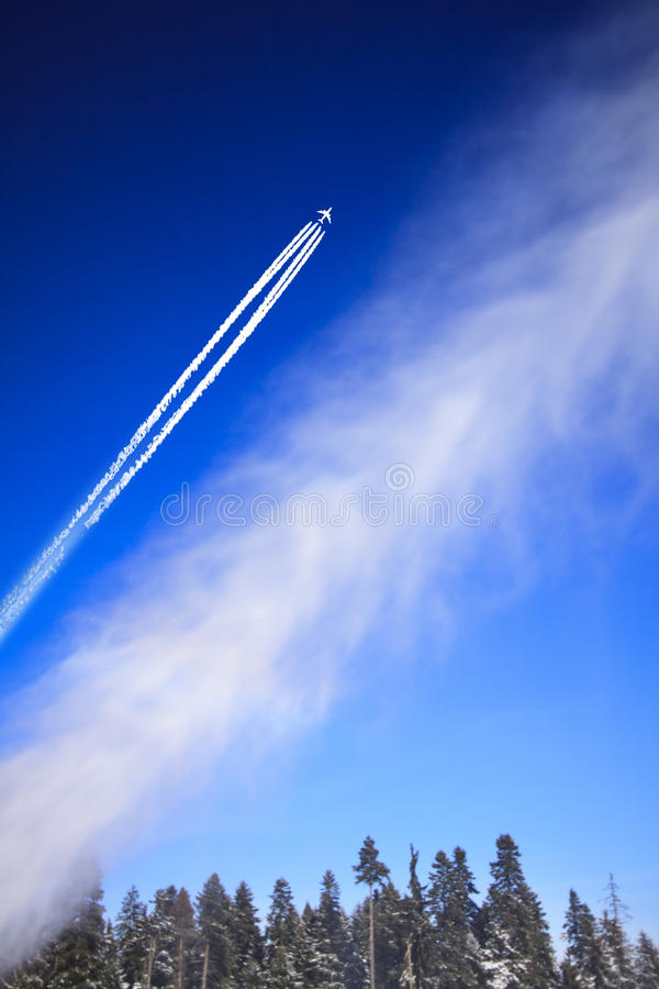 Plane in blue sky. royalty free stock photo