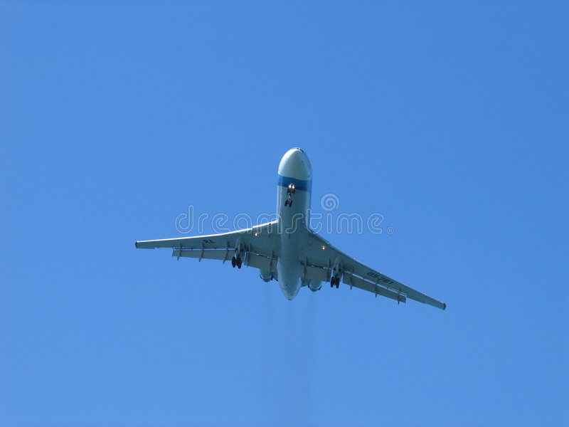 The plane in blue sky royalty free stock photography