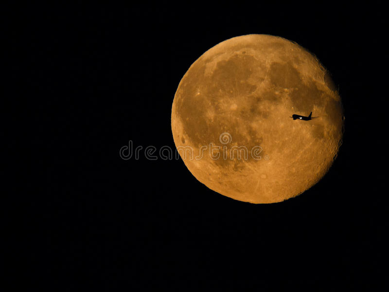 Download Plane crossing moon stock photo. Image of night, silhouette - 88963348
