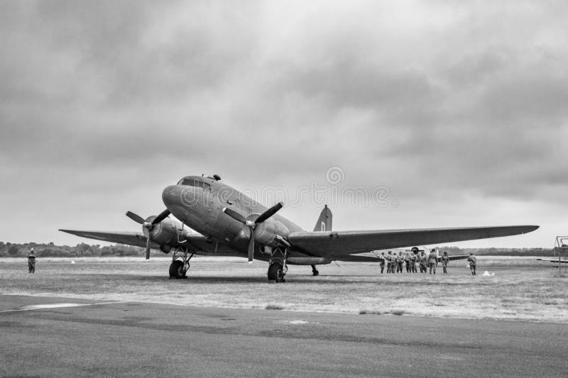 Plane Douglas C-47 Skytrain, DC-3 United States Army Air Force, L4, Dakota Royal Air Force, R-40 US Navy, landing in Normandy. Douglas c-47 skytrain, . c47, 3 royalty free stock image