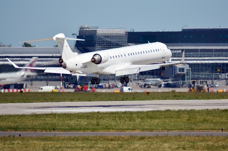 Plane ES-ACL - Bombardier CRJ-900LR - Regional Jet just before landing at the Chopin airport stock photo