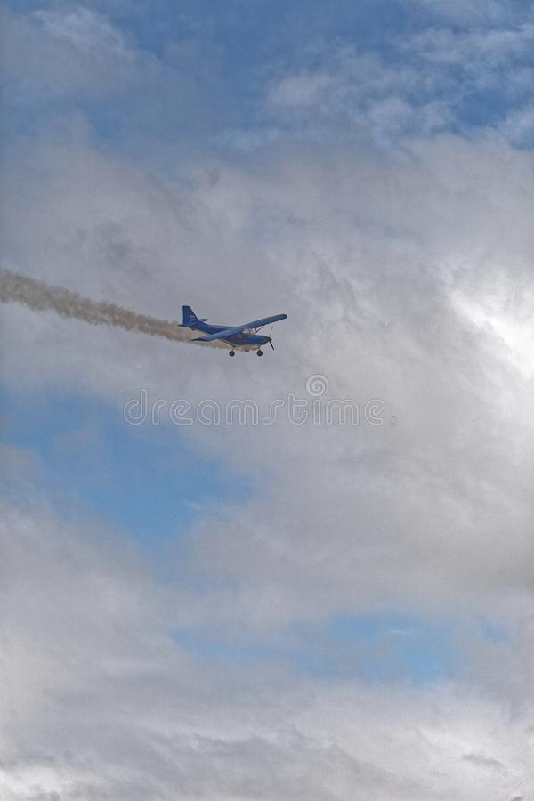 Plane flies through the cloudy sky royalty free stock images