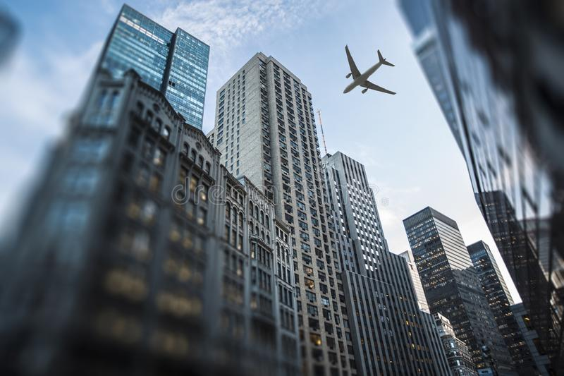 plane flies over the city over New York royalty free stock photography
