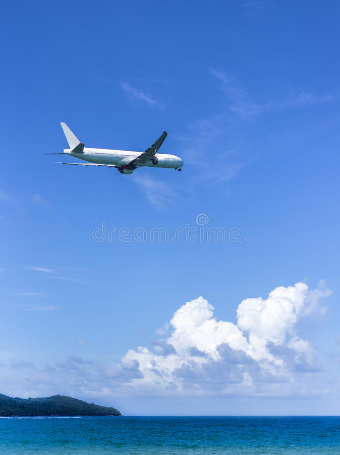 Plane fly over the sea stock images