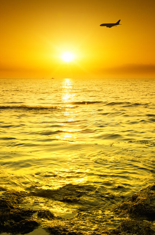 Download Plane Fly Over Water During Sunrise Stock Image - Image of atmosphere, sunlight: 28865343
