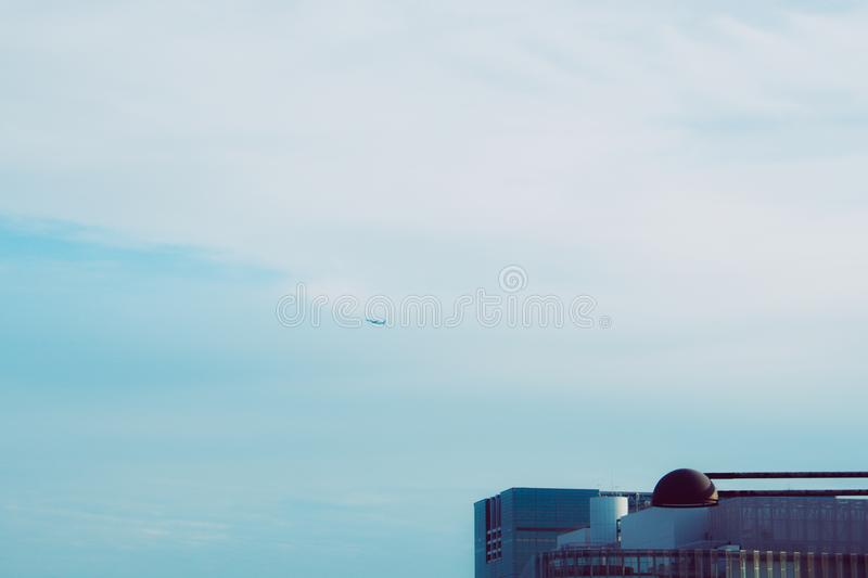 Plane Flying on Blue Sky royalty free stock image