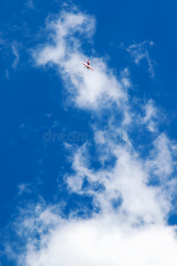 Plane flying down stock photography