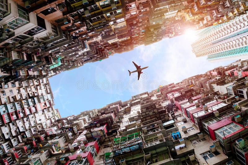 Plane Flying Over Crowded Houses in Quarry Bay, Hong Kong royalty free stock photos