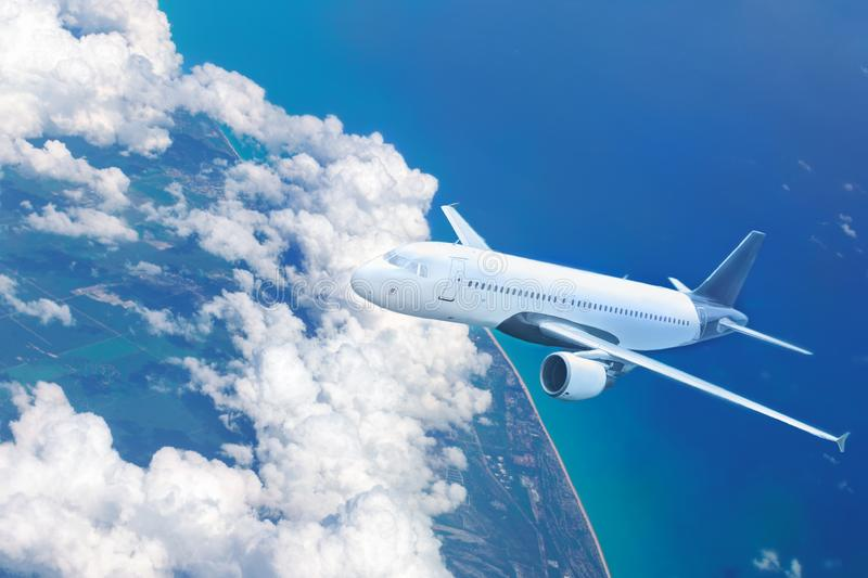 Plane flying in the sky. Aerial photo from airplane near Malaysia. Sea and land from plane. royalty free stock photos