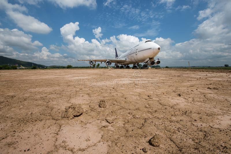 Plane on the ground. With blue sky and white clouds stock image