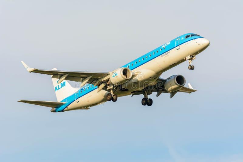 Plane from KLM Cityhopper PH-EZS Embraer ERJ-190 is preparing for landing royalty free stock images
