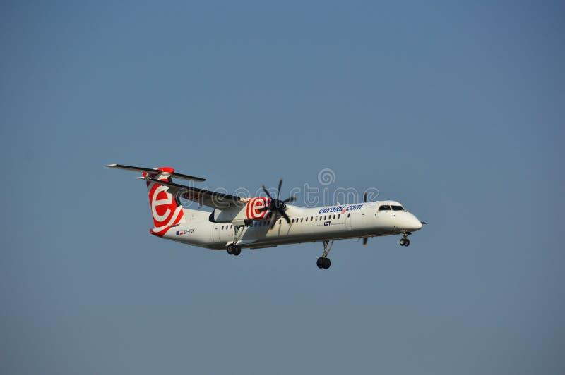 Plane landing - Eurolot royalty free stock photography