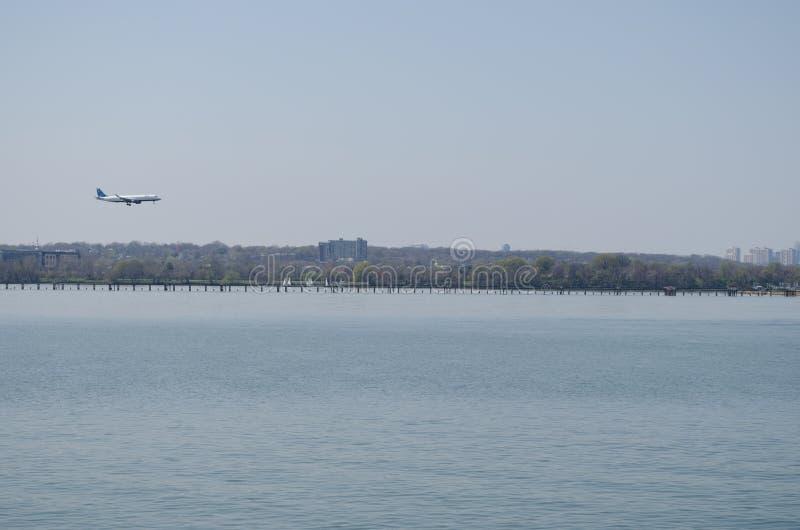 Plane landing at national airport Washington DC. Over Potomac river stock image