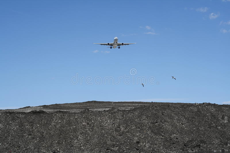 Plane Landing. A passenger jet on landing approach stock images