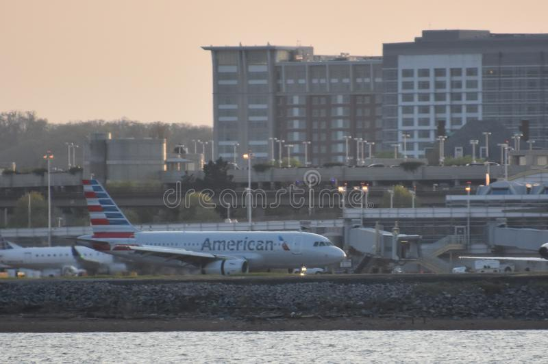 Plane landing at Ronald Reagan Airport in Washington, DC. As viewed from Hains Point stock image