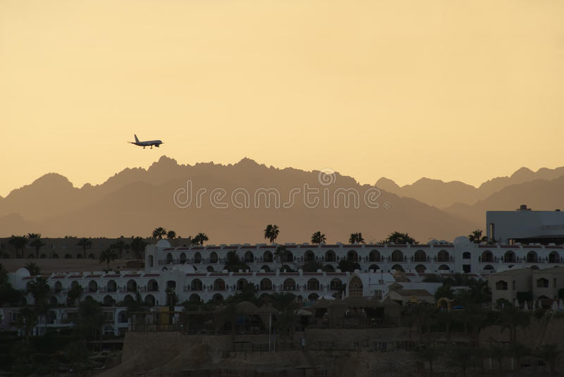 Plane lands on the background of the mountains royalty free stock photos