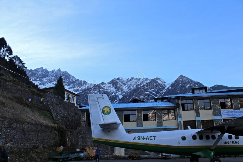 Plane at Lukla Airport stock images