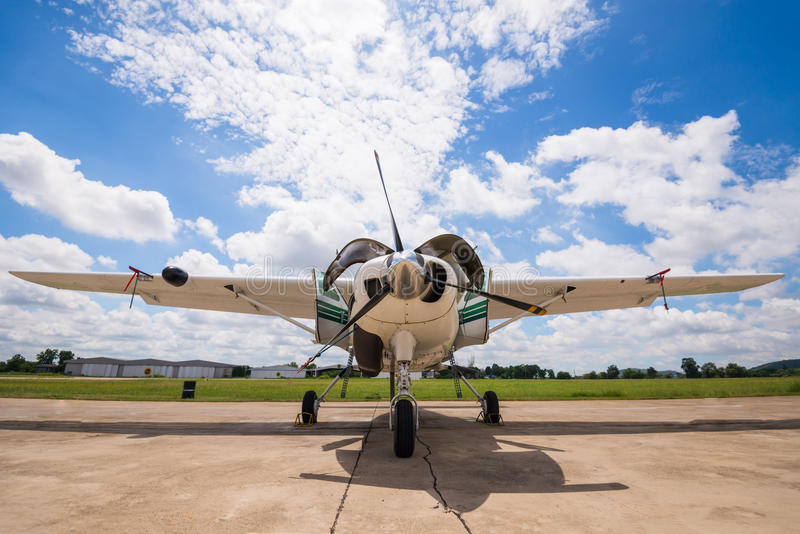 The plane made artificial rain stock photography