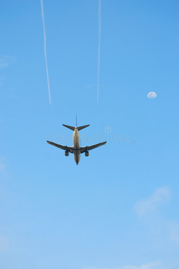 Plane and moon royalty free stock photos