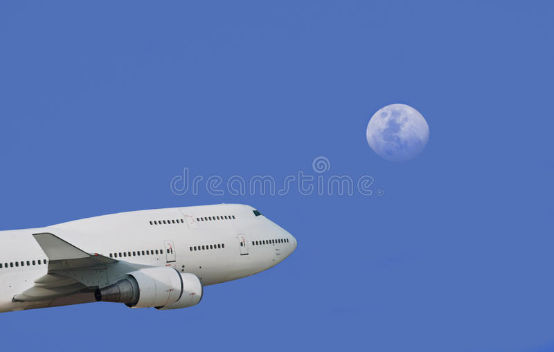 Plane & moon in depth of sky royalty free stock photo