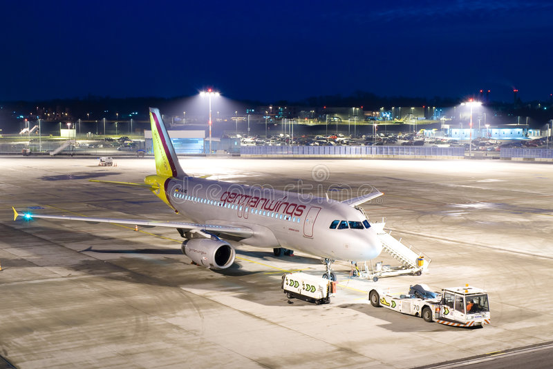 Plane at night. Germanwings plane at night at the cologne airport, germany. waiting for pushback royalty free stock photo