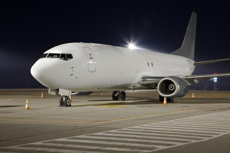 Plane at night. Cargo plane at an airport stock photo