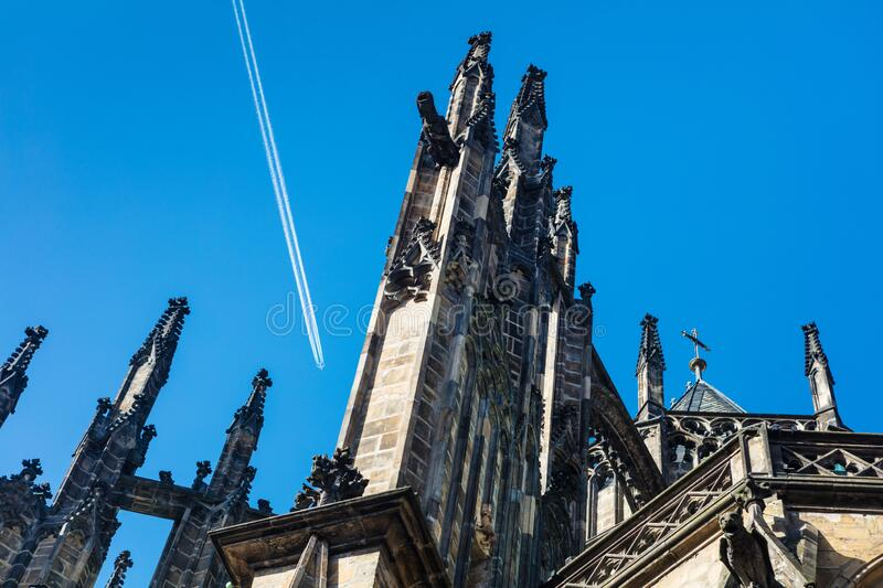 Plane over famous St. Vitus Cathedral in Prague stock photo