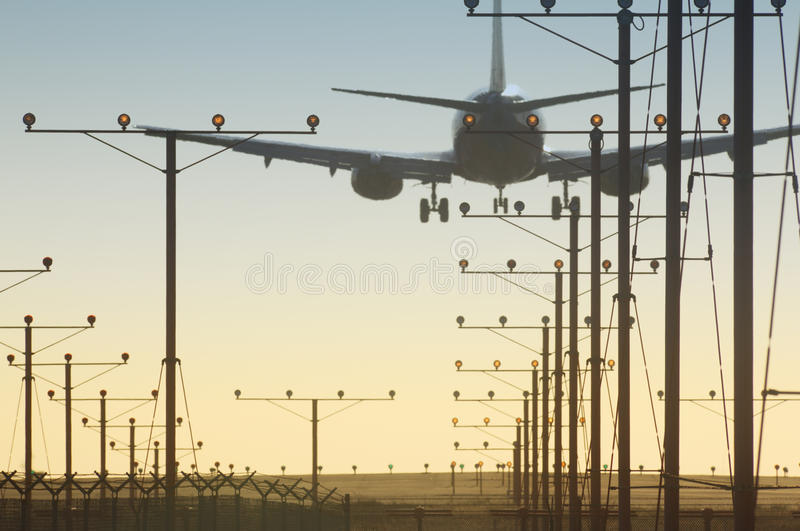 Plane over runway. Plane landing over runway in airport royalty free stock photography