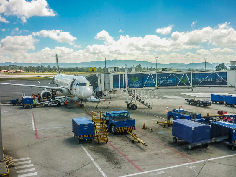 Plane Parked at Medellin Airport. MEDELLIN, COLOMBIA, DECEMBER 30 - 2014 - Perspective view of plane parked at airport receiving provision in Medellin airport in royalty free stock photo
