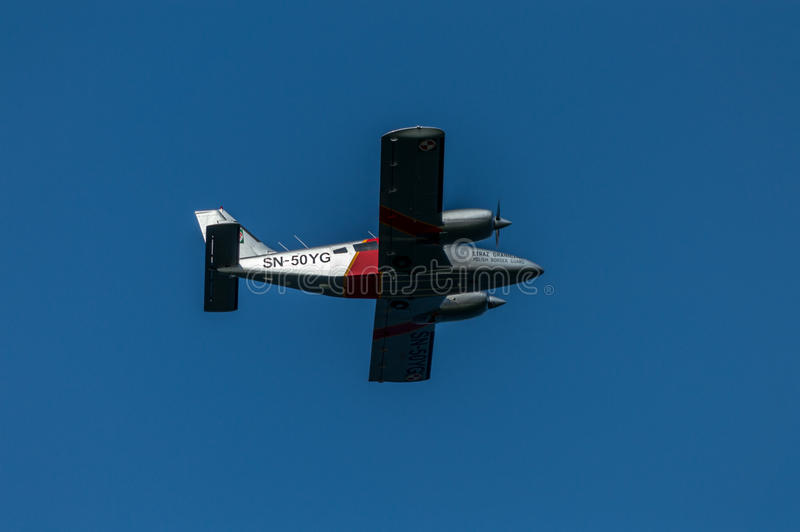 Plane - Polish Border Control flying across coast of Baltic Sea in Poland on a blue sky background.  royalty free stock image