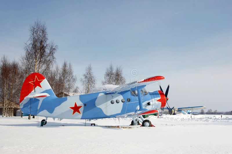 Plane with red star on the snow stock photos