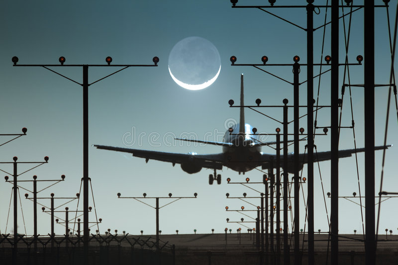 Plane runway. Plane landing night airport runway royalty free stock photography