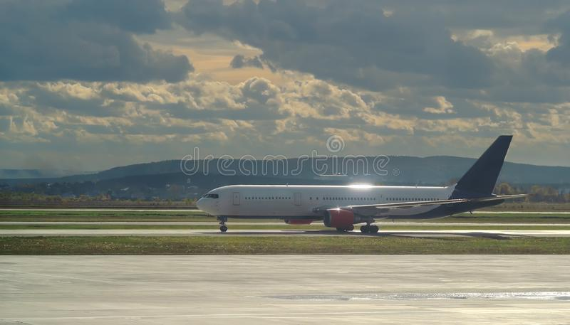 The plane on the runway to get ready to take off and fly to transport passengers. royalty free stock images