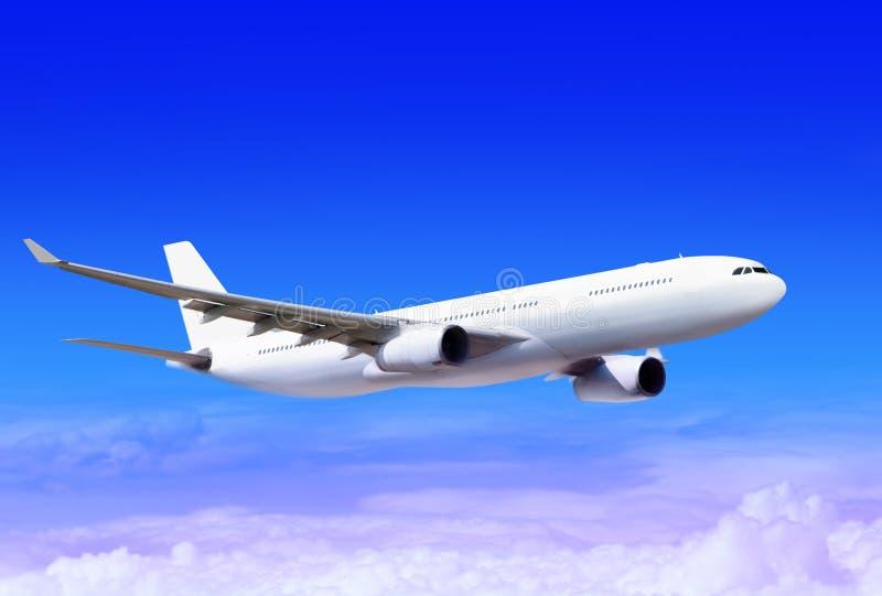 Plane in the sky. White passenger plane in the blue sky landing away stock image