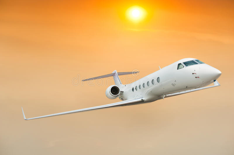 Plane in the sky. Plane in the nice sky with sun stock photography