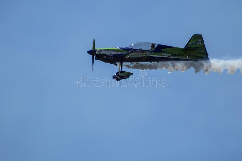 The Plane Smoking the Sky. `The Plane Smoking the Sky` is photo taken at the Thunder in the Valley Airshow 2017, located in Columbus, Georgia stock photography